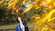 istock Throwing Autumn Leaves 1322608863