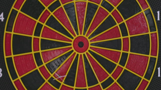 Throwing Darts at Electronic Dart Board in Game Room - Close Up
