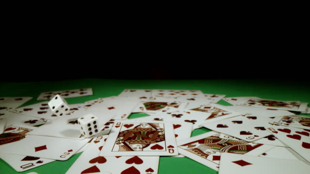 SLO MO Throwing dices on playing cards