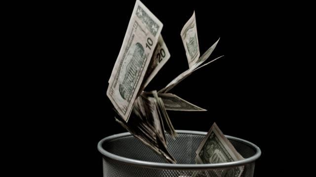 slo mo throwing money away - потеря стоковые видео и кадры b-roll