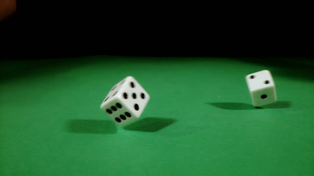 SLO MO Throwing two dices on a gambling table