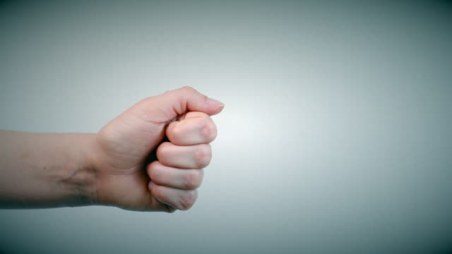 thumb up showing it is ok on white background - estatico video stock e b–roll