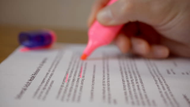 Thumbing pages and highlighting text with pink marker video