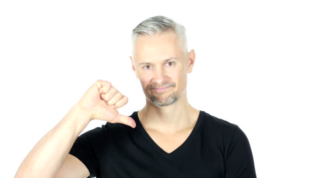 Thumbs Down by Sad Middle Aged Man, White Background video
