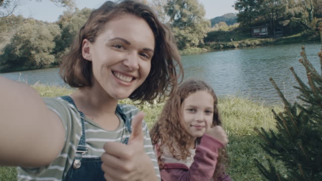 thumbs up for selfie! - 8 9 anni video stock e b–roll
