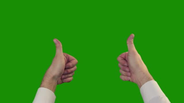 thumbs up on the green chroma key - thumbs up stok videoları ve detay görüntü çekimi