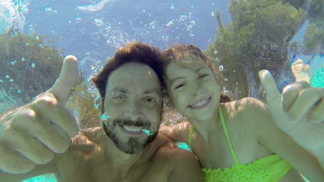 Thumbs up underwater video