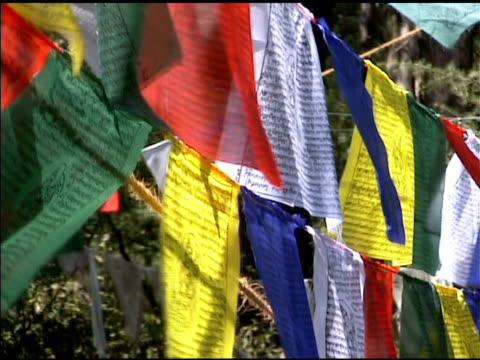 Tibetan Buddhist Prayer Flags 1 Tibetan Buddhist Prayer Flags on a mountaintop near Dharamsala, India. philosophy stock videos & royalty-free footage