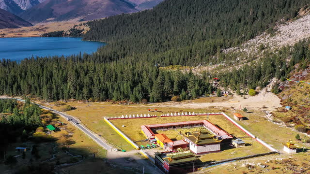 Tibetan Buddhist temples face a jungle and lake