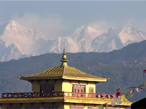 Tibetan monastery, Kathmandu, Nepal, with snowcapped Himalayas and Prayer Flags video