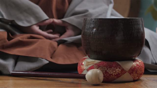 Tibetan Monk Morning Ritual Meditating with Sound Bowl