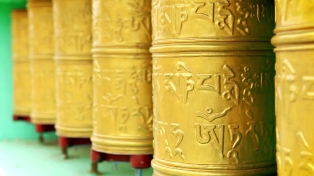 Tibetan praying wheels rotating in the monastery in Ladakh, India video