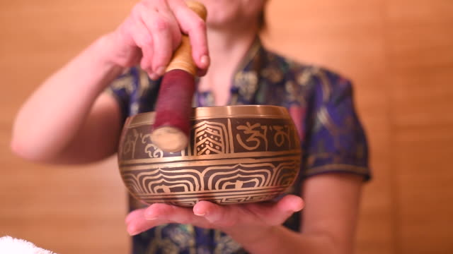 tibetan singing bowls in action - alternative medicine stock videos and b-roll footage