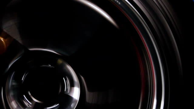 tight shot of car wheel spinning video