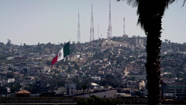 tijuana urban sprawl - bandiera nazionale video stock e b–roll