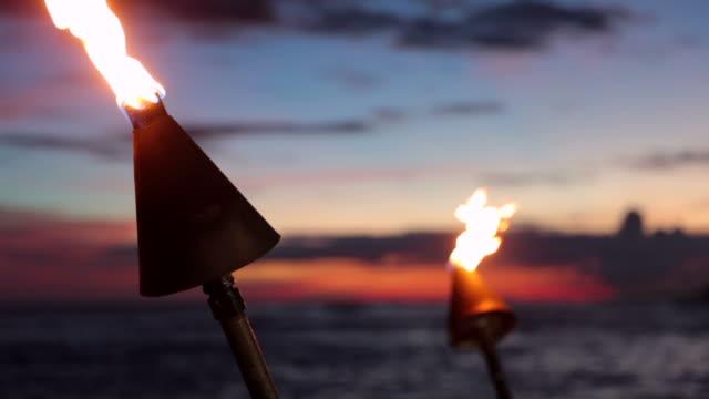 Tiki Torch Flames on Tropical Beach at Sunset, Kauai, Hawaii