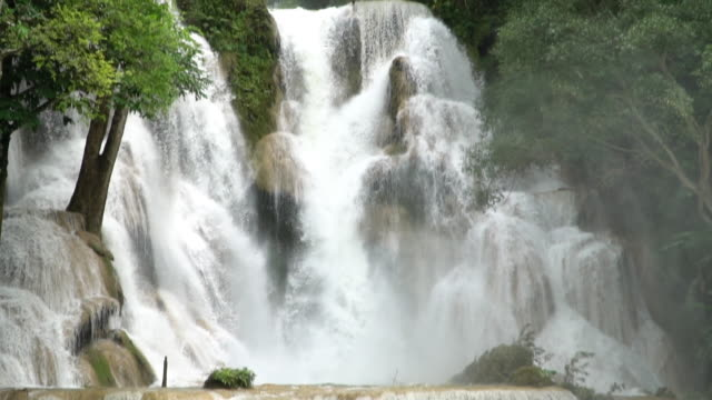 Tilt down and Slow motion of Kuang Si waterfall in Luang Prabang, Laos. video