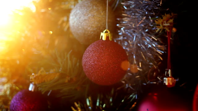 tilt down. christmas tree with ornaments and defocused lights - tilt down stock videos & royalty-free footage