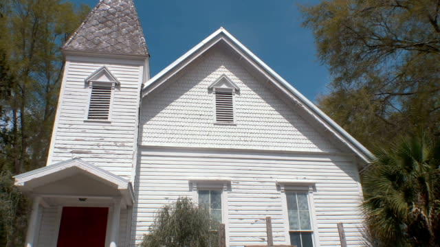 Tilt Down From Church Steeple to Bright-Red Door, 4K