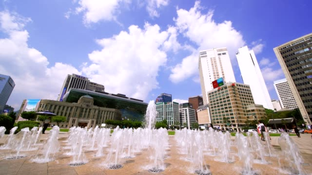 tilt down of fountains in front seoul city hall in seoul plaza,korea. the building was constructed by the japanese occupation government in 1926. - tilt down stock videos & royalty-free footage