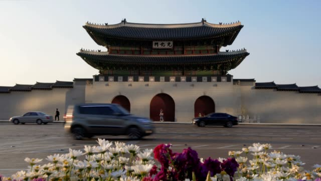 Tilt down ofGyeongbokgung Palace In South Korea, with the name of the palace 'Gyeongbokgung' on a sign shot with FS7 Sony gwanghwamun gate stock videos & royalty-free footage