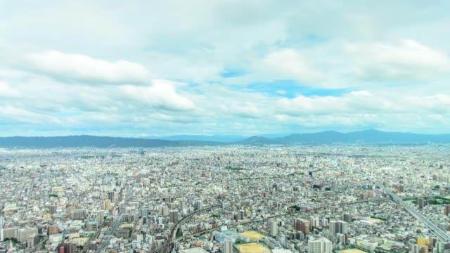 4k tilt down panning timelapse aerial view of osaka city from abeno harukas in osaka , japan - небольшой город стоковые видео и кадры b-roll