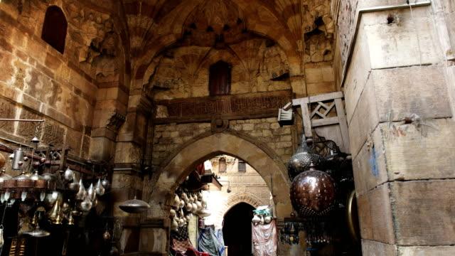 tilt down shot of khan el khalili market in cairo, egypt - souk video stock e b–roll