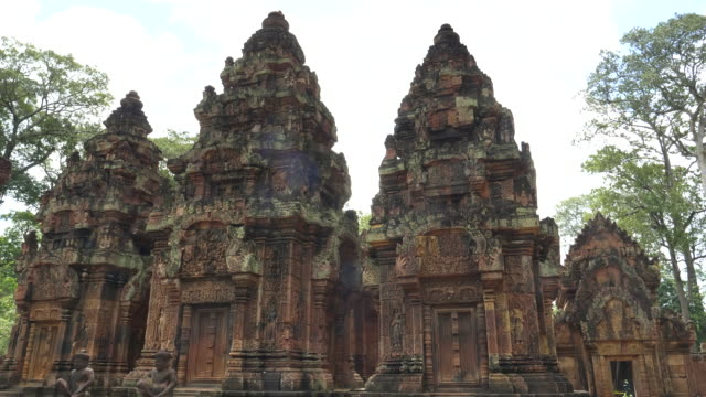 tilt down shot of towers at banteay srei temple in angkor region