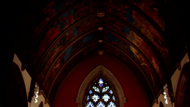 Tilt from Beautiful Ancient Christchurch Painted Ceiling to Altar and Stained video