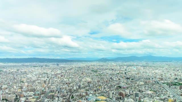 4k チルトパンニング大阪の阿倍野ハルカスから大阪市の空中写真を撮影。 - デッキ点の映像素材/bロール
