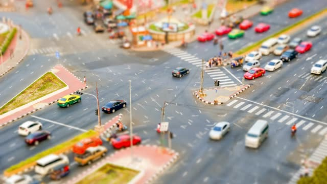 Tilt shift interaction road with transportation cars and people