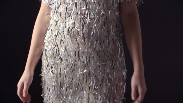 Tilt shot of glamorous woman wearing a sparkly dress video
