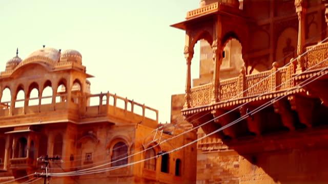 Tilt shot of Jaisalmer's elaborately sculpted sandstone havelis. video