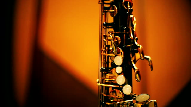 Tilt up camera : Saxophone standing on a stage. video