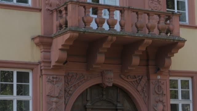 Tilt up close up- Facade of building  'Haus zum Riesen' Heidelberg, Germany video