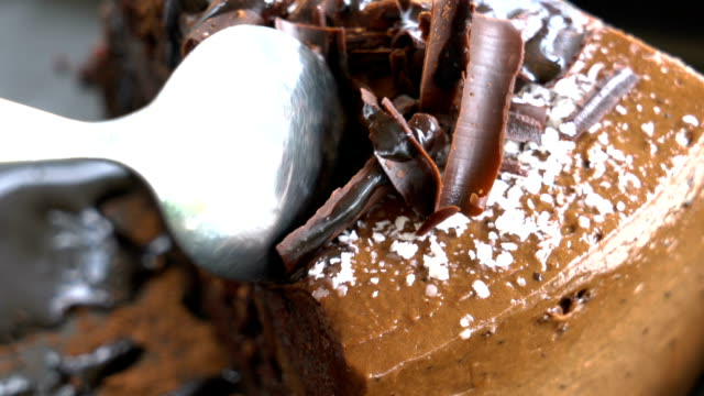 Tilt up Cutting Chocolate cake close up. video