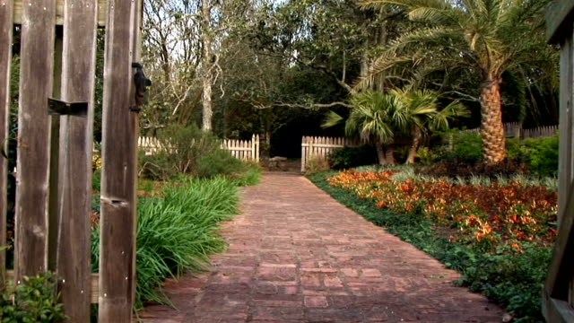 Tilt Up Open Gate Jib shot of an old wooden gate opening to show the garden inside ornamental garden stock videos & royalty-free footage