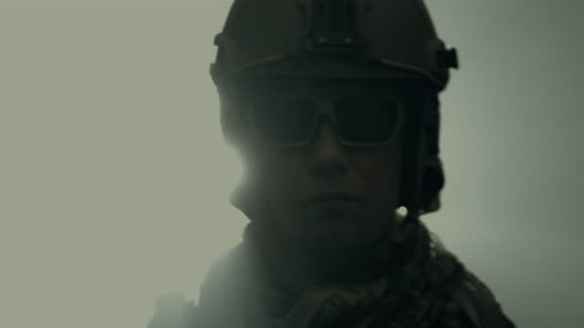 Tilt up portrait of soldier in full US Army uniform, turn around with silhouette backlight and smoke. Portrait, backlight, smoke, Career, Slow motion, Adult, Lifestyle, soldier, silhouette, military, usa, war, turning, back lit stock videos & royalty-free footage