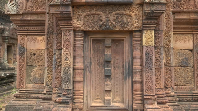 tilt up shot of beautiful carving at banteay srei temple in angkor