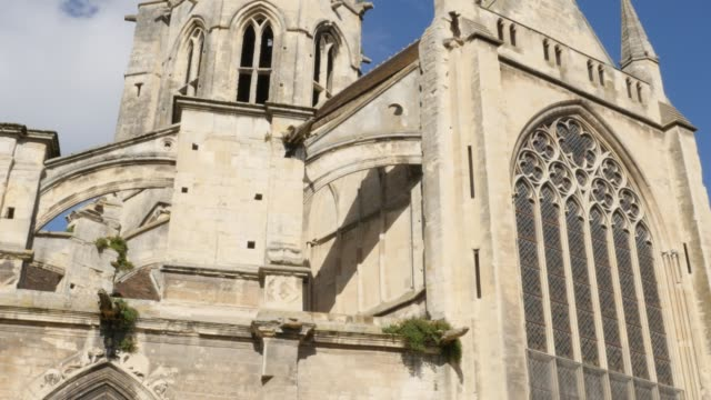 Tilting on Caen St Etienne le Vieux remains in the centr of the city of Caen Tilting on Caen St Etienne le Vieux remains in the centr of the city of Caen 4K 2160p 30fps UHD footage - Ruins of Saint-Etienne-le-Vieux in Normandy Calvados by the day 4K 3840X2160 UltraHD video caen stock videos & royalty-free footage