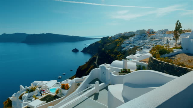 Tilting Panoramic Shot Santorini Cliff and Aegean Sea in the Afternoon video