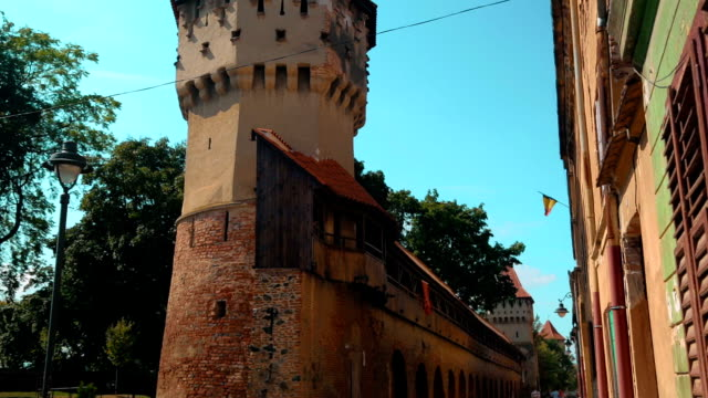 Tilting shot showing medieval ruins of a watch tower in the town of Sibiu, Transylvania, Romania video