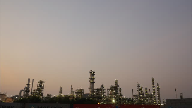 Time laps of Oil refineries with sun rise