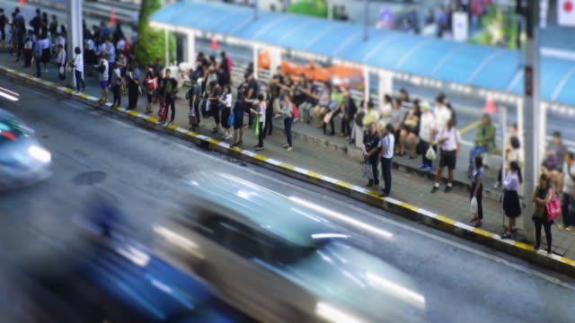 4K time lapse 4096x2160 : People wait and get on the bus - road with cars - night city video