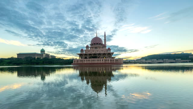 Time lapse 4k Footage of dramatic Sunrise At Putra Mosque, Putrajaya. Tilt up. video