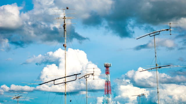 Time lapse : Aerial television antenna with cloud moving and blue sky video