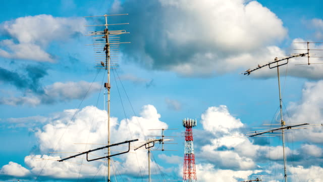 Time lapse : Aerial television antenna with cloud moving and blue sky, panning shot video