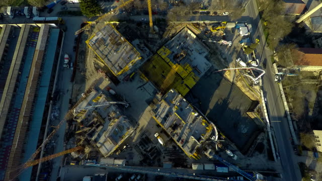 time lapse, aerial view of building and working at construction site. - bułgaria filmów i materiałów b-roll