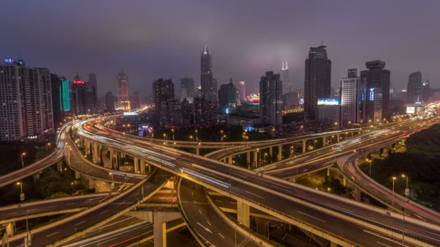 Time Lapse- Aerial View of Busy Road Intersection at Night, Yan'an Bridge (WS Zoom Out) Aerial View of Busy Overpass in Shanghai at Night fork stock videos & royalty-free footage