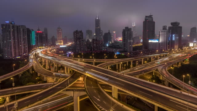 Time Lapse- Aerial View of Busy Road Intersection at Night, Yan'an Bridge (WS LR Pan) video